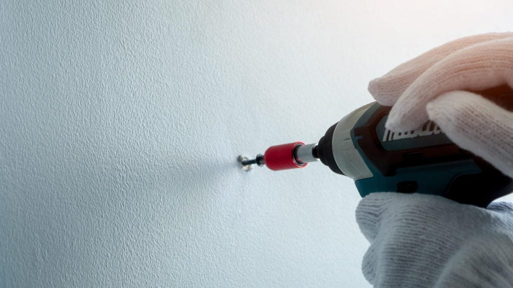 How to Screw Into Plaster Walls Without Crumbling Them to Pieces
